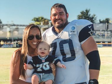Cowboys offensive lineman Zack Martin poses with his wife, Morgan, and his son, Charlie, at training camp in Oxnard, Calif.