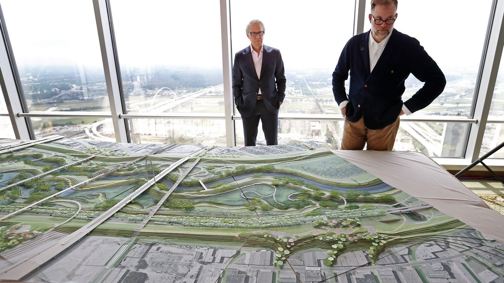 Brent Brown (right), architect and founding director of BC Workshop and Dallas CityDesign Studio, and John H. Alschuler, chairman of HR&A, are seen in an interview talking about a model of the Trinity River Park plan at the City Club in Dallas, Thursday, May 19, 2016.
