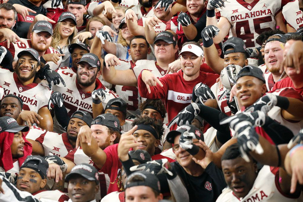 Oklahoma Sooners head coach Lincoln Riley and his players give the horns down hand signal after defeating the Texas Longhorns in the Big 12 Championship at AT&T Stadium in Arlington, Texas, Saturday, December 1, 2018. The Sooners defeated the Longhorns, 39-27. (Tom Fox/The Dallas Morning News)