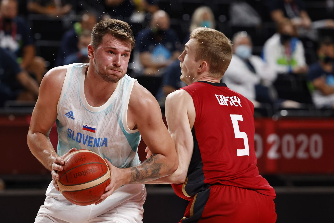 Slovenia's Luka Doncic (77) drives on Germany's Niels Giffey (5) during the first half of play of a quarter final basketball game at the postponed 2020 Tokyo Olympics at Saitama Super Arena, on Tuesday, August 3, 2021, in Saitama, Japan. (Vernon Bryant/The Dallas Morning News)
