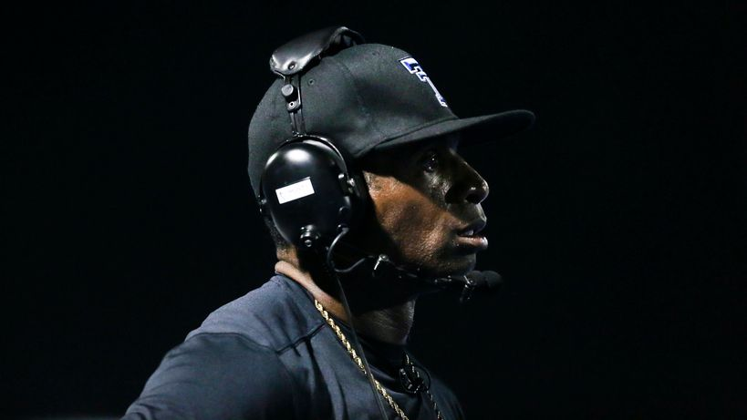 Trinity Christian-Cedar Hill offensive coordinator and retired professional football player Deion Sanders watches a play during a high school football game between Parish Episcopal and Trinity Christian-Cedar Hill on Thursday, Sept. 5, 2019 in Dallas.