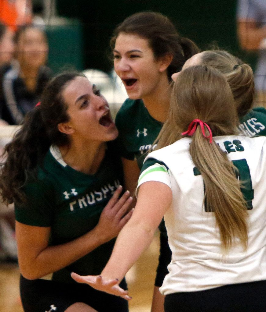 Prosper's Taylor Youtsey (16), center, was all smiles as she celebrates with teammate Sami Jacobs (4), left, and others after blocking the shot of a Plano West player during the first game of their match. The two teams played their District 9-6A volleyball match at Prosper High School in Prosper on October 22, 2019. (Steve Hamm/ Special Contributor)