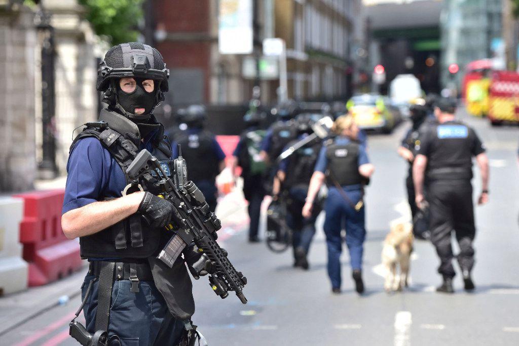 Armed police on St Thomas Street, London, Sunday June 4, 2017, near the scene of Saturday night's terrorist incident on London Bridge and at Borough Market.