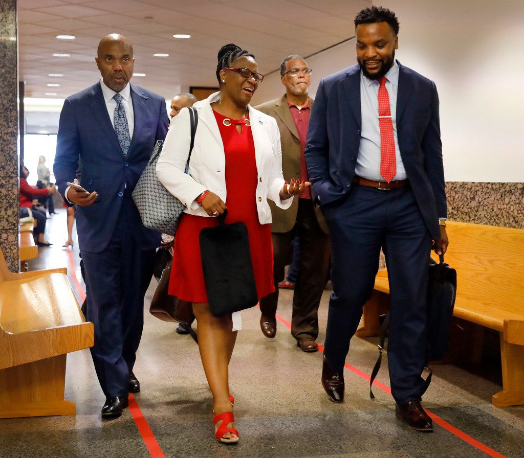 Botham Jean's mother, Allison Jean, leaves the courtroom with civil rights attorneys Lee Merritt (right) and Benjamin Crump at the Frank Crowley Courts Building in Dallas.
