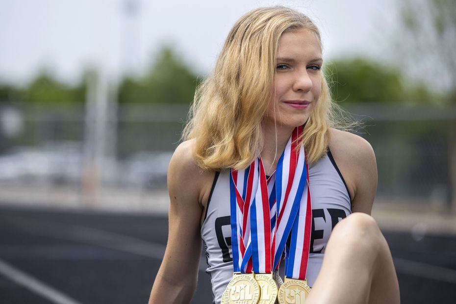 Denton Guyer senior track runner Brynn Brown poses for a portrait at the John H. Guyer High School track in Denton, Texas, on Wednesday, May 19, 2021. Brown is The Dallas Morning News' All-Area Girls Track and Field Athlete of the Year. She won Class 6A state titles in the 1,600 and 3,200 meters and broke her own state-meet record in the 3,200.