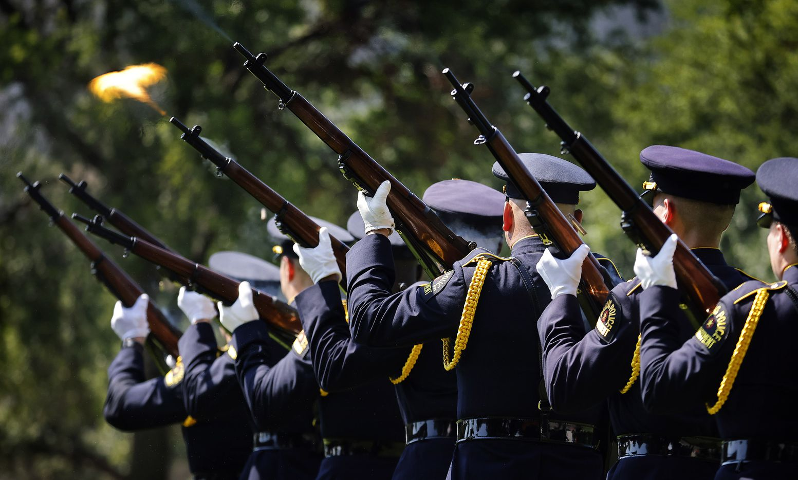 A 21-gun salute was given by the Dallas Police Honor Guard during the 2021 Police Memorial Day at the Dallas Police Memorial in downtown Dallas, Wednesday, July 7, 2021. It was the 5th anniversary of the July 7th ambush and special recognition was given to those officers who were killed. (Tom Fox/The Dallas Morning News)