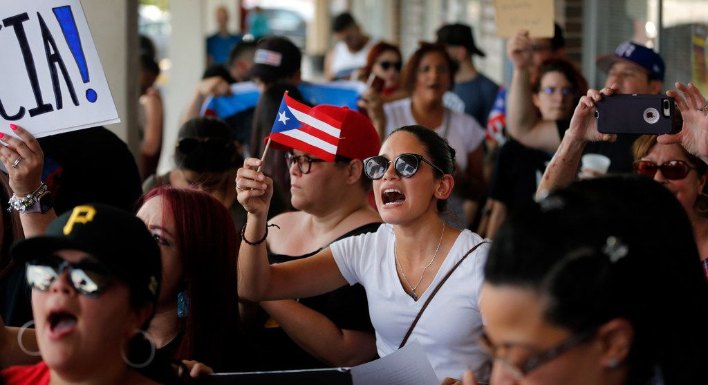 Hundreds of people from North Texas' Puerto Rican community protested Gov. Ricardo Rosselló outside the Adobo Puerto Rican Cafe in Irving on Sunday.
