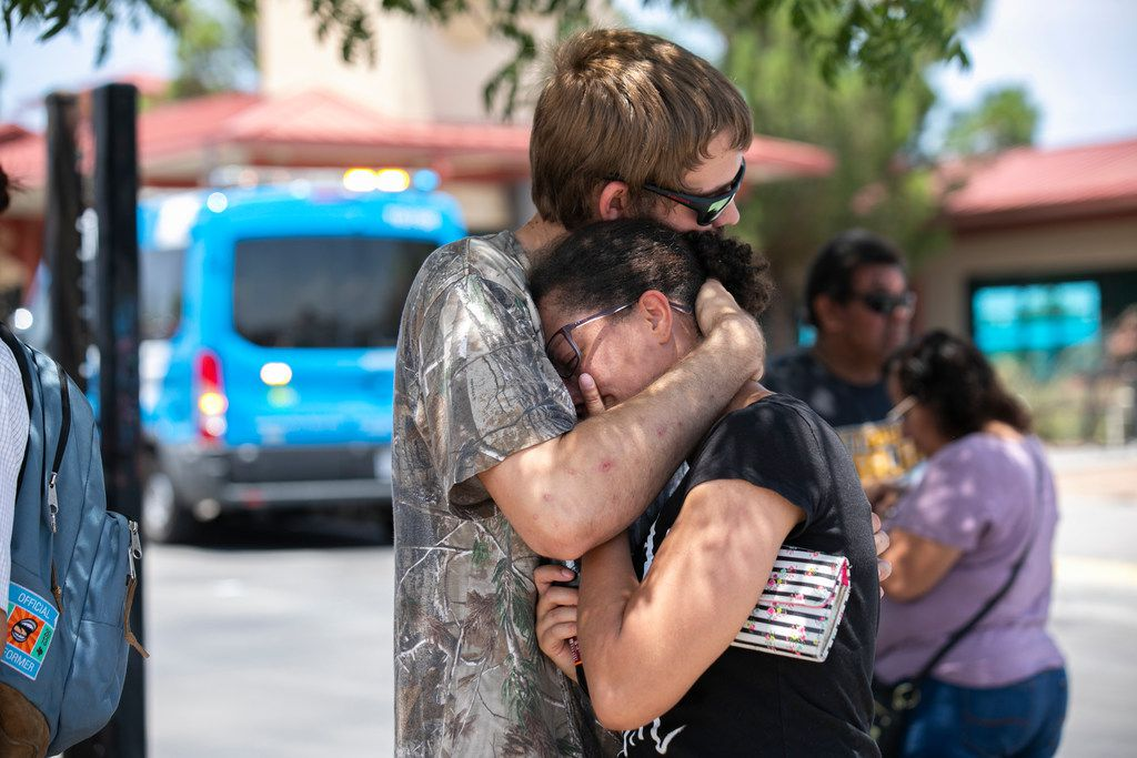 Kianna Long and husband Kendall Long embrace near the Walmart where a man opened fire on back-to-school shoppers, Saturday, August 3, 2019, in El Paso, Texas. The couple were both inside the Walmart when the shooting started. They were in the freezer section and ran outside and hid inside storage containers with other people until helped arrived.