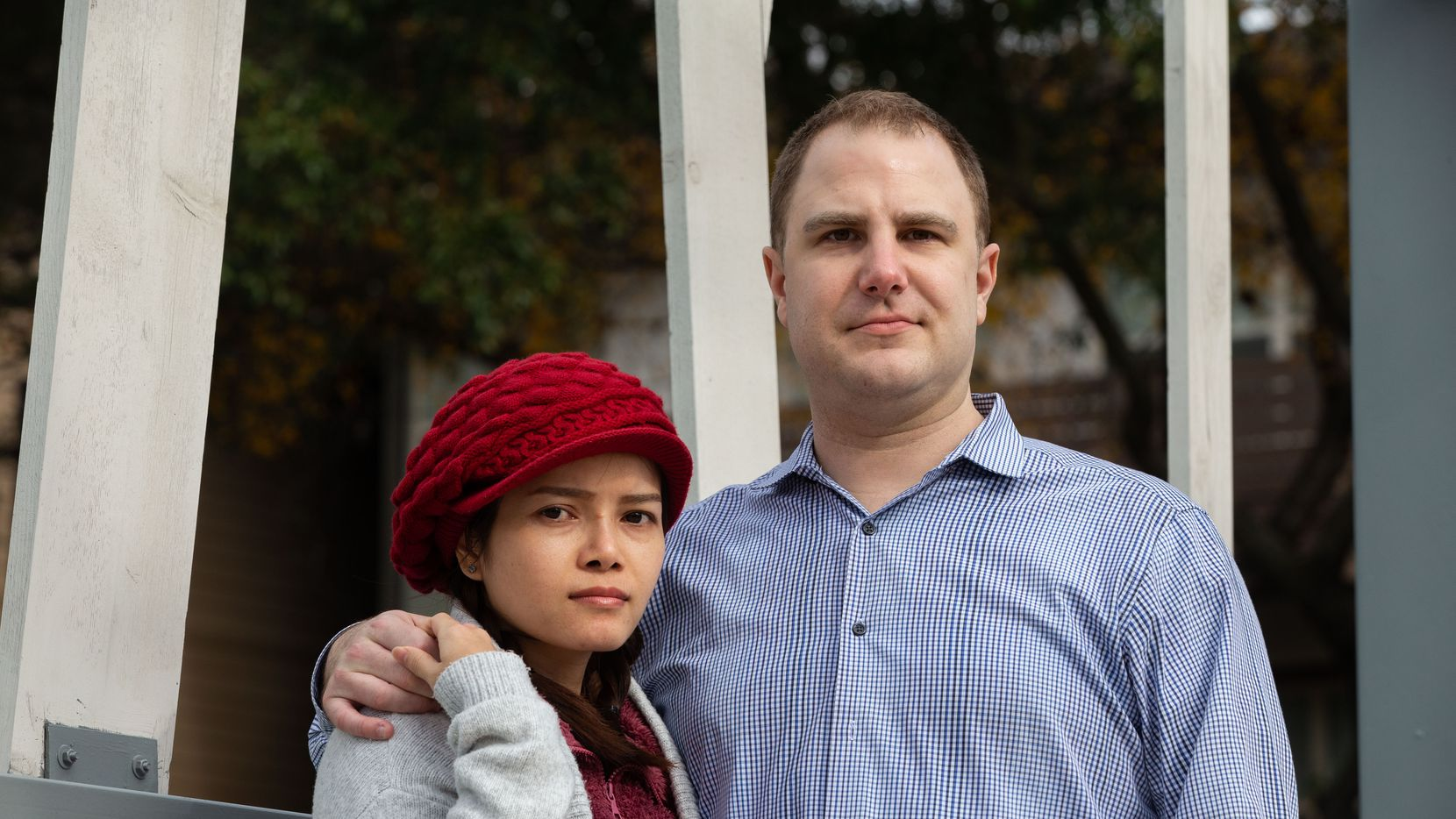 Spouses Aaron Jones (right) and Trinh Nguyen pose for a portrait at their apartment complex in Dallas on Friday, Dec. 18, 2020. Jones, a U.S. citizen, and Nguyen, a Vietnamese-born legal resident, filed their joint federal income taxes this year with Jones's Social Security Number and Nguyen's ITIN, a tax identification number used by both legal immigrants and unauthorized immigrants — a move that earlier this year knocked them both out of receiving about $2400 in federal stimulus check money offered this year due to the pandemic.