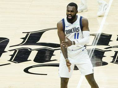 Dallas Mavericks forward Tim Hardaway Jr. (11) celebrates after hitting a 3-pointer during the third quarter of an NBA playoff basketball game against the LA Clippers at the Staples Center on Wednesday, June 2, 2021, in Los Angeles.