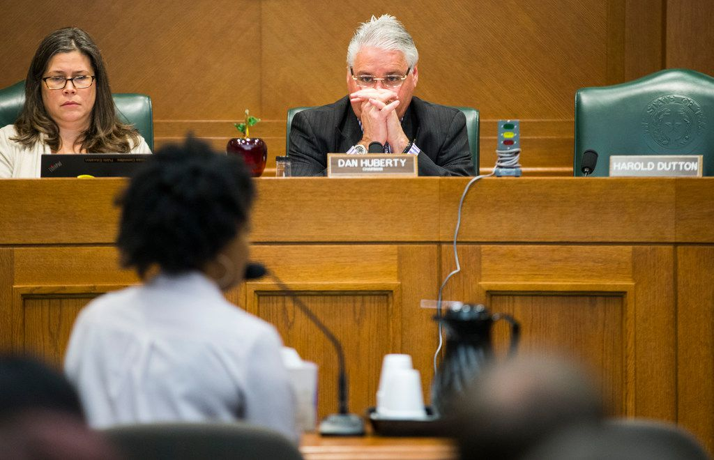 Rep. Dan Huberty (center) listened to Sakennia Reed, a seventh-grade English and language arts teacher at the Barack Obama Male Leadership Academy in Dallas, speak during a Public Education Committee hearing Tuesday, March 12, 2019, at the Capitol in Austin. (Ashley Landis/The Dallas Morning News)