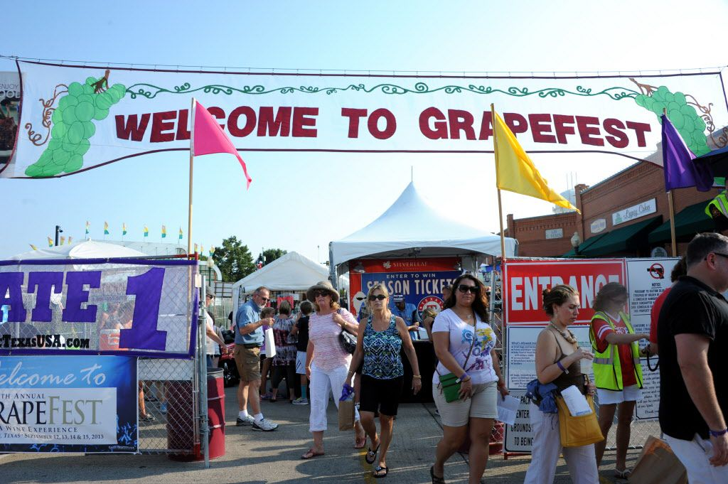 GrapeFest attendants head home at the 27th Annual GrapeFest on Main Street in Grapevine, TX on September 14, 2013. The annual festival was cancelled for 2020 due to COVID-19 safety concerns.
