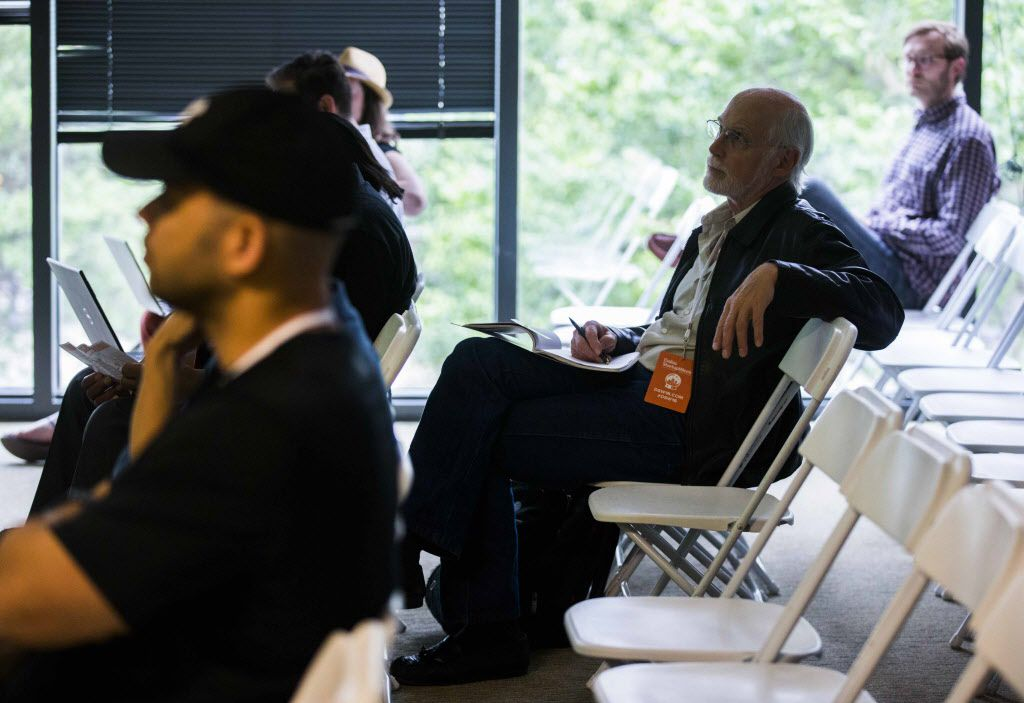 """Leroy Levin (center) of Richardson, Brock Carpenter (right) of Oak Cliff and other participants listen during a session called """"Hackathon 101"""" at Dallas Startup Week activities on Tuesday, April 12, 2016 at 1700 Pacific Avenue in Dallas.  (Ashley Landis/The Dallas Morning News)"""