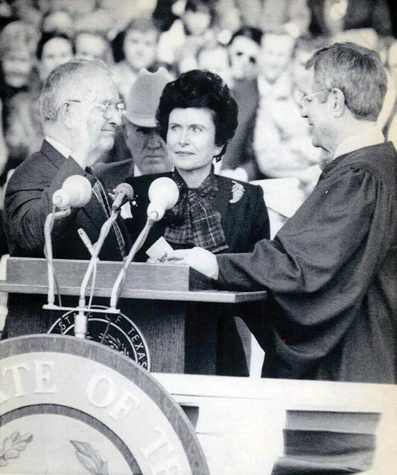 AUSTIN, TEXAS - January 20, 1987 - TEXAS GOVERNOR SWORN IN - William  P. Clements (left) takes the oath of office Tuesday as Texas Governor from Supreme Court justice John HIll.  Clements' wife Rita looks on.  Clements, a Republican, succeeded democrat Mark White.