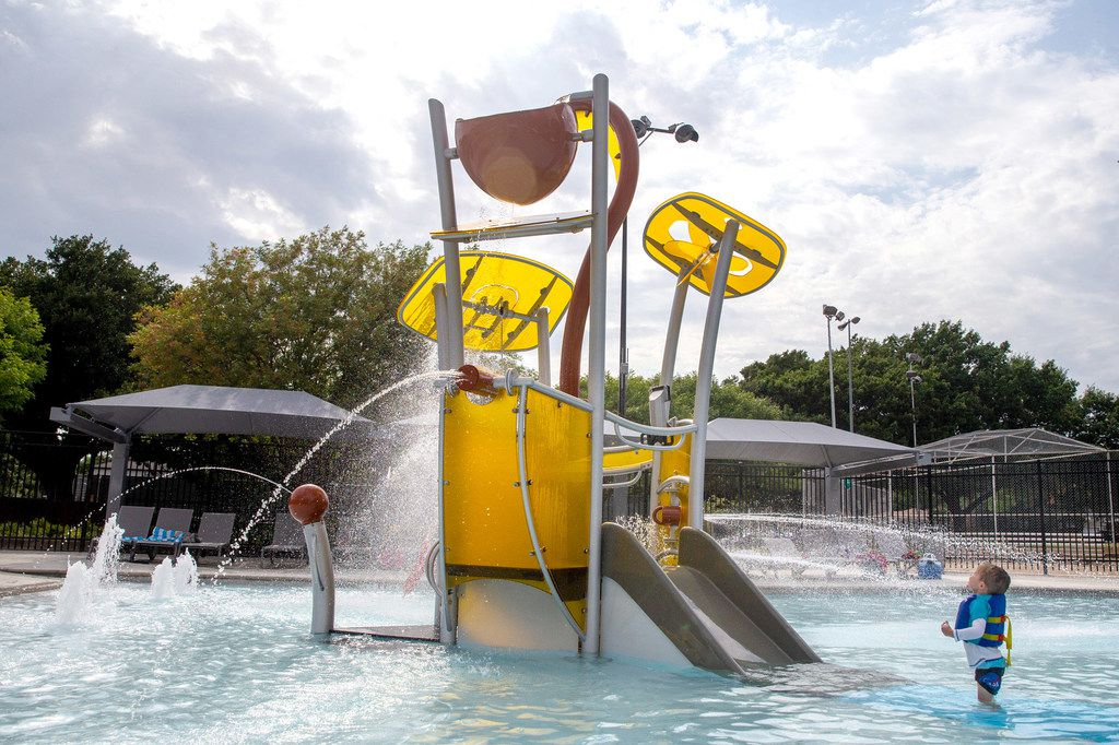 Jack Ward, 3, played at the Tietze Neighborhood Aquatic Center in Old East Dallas neighborhood of Dallas last month. Tietze is one of the six outdoor Dallas pools the city has renovated since 2018.