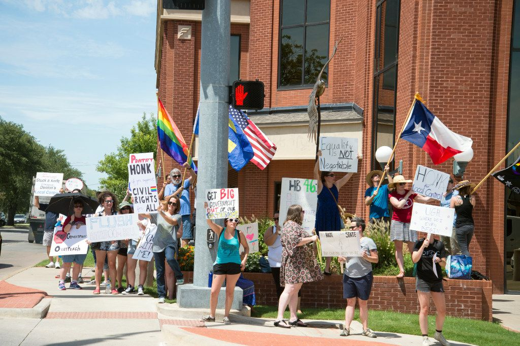 "Protesters gathered outside state Rep. Lynn Stucky's office in Denton on July 28 to protest his support for a state ""bathroom bill"" restricting transgender people's bathroom access."