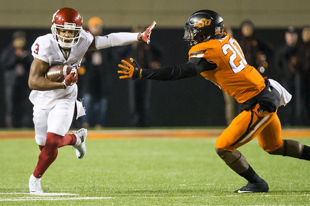 Oklahoma wide receiver Sterling Shepard (3) tries to get around Oklahoma State linebacker Jordan Burton (20) during the second quarter of an NCAA football game at Boone Pickens Stadium on Saturday, Nov. 28, 2015, in Stillwater, Okla. (Smiley N. Pool/The Dallas Morning News)
