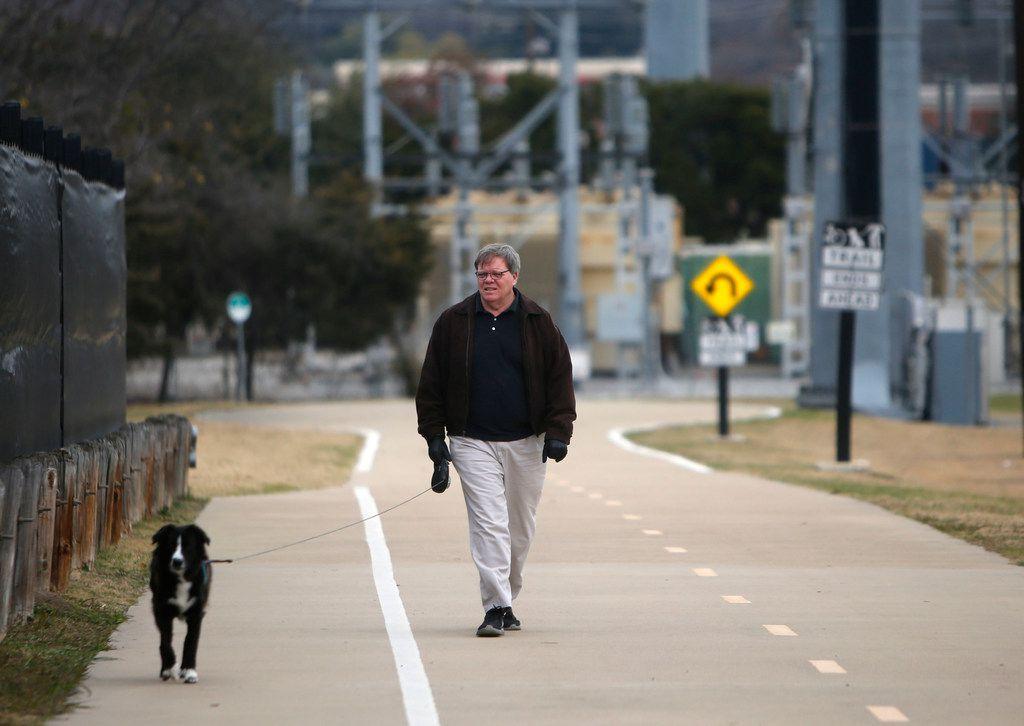 Tim Allen walks his dog Bailer along Northaven Trail in North Dallas.