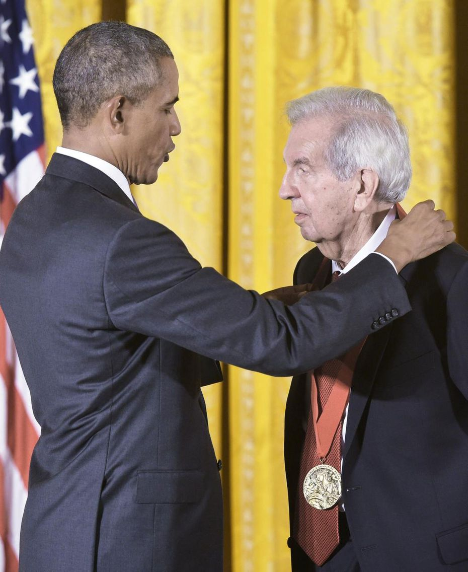 President Barack Obama awards a 2014 National Humanities Medal to Larry McMurtry at the White House.