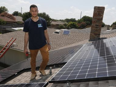 Mohammed Abdalla, owner of Good Faith Energy, poses for a portrait on a roof where he and his crew installed solar panels in Richardson. (David Woo/The Dallas Morning News).