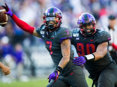 TCU Horned Frogs safety Trevon Moehrig (7) celebrates an interception with defensive tackle Ross Blacklock (90) during the third quarter of an NCAA football game between the University of Texas and TCU on Saturday, October 26, 2019 at Amon G Carter Stadium in Fort Worth. (Ashley Landis/The Dallas Morning News)