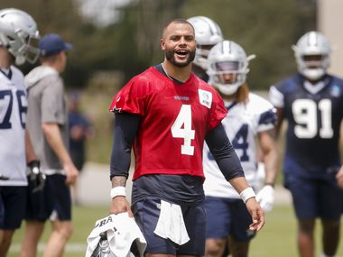 Dallas Cowboys quarterback Dak Prescott (4) takes his helmet off during the Cowboys second OTA practice on Thursday, June 3, 2021, at the Star in Frisco.