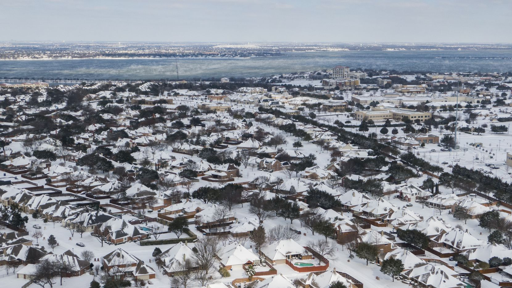 An aerial view of snow-covered Rockwall neighborhoods looking northwest on Feb. 15.