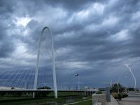 Lightning strikes in West Dallas as a thunderstorms roll past the Margaret Hunt Hill Bridge, Wednesday evening, July 10, 2019.