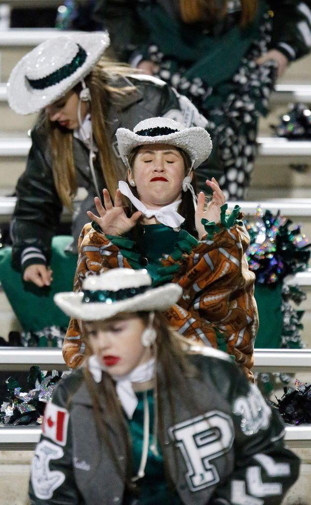 Rowan Abrams, 15, with the Prosper High School Talonette drill team, feels the bite of cold air as the team prepares to take the field as Prosper High School hosted Mesquite High School in a Class 6A Division I area-round playoff game at Eagle Stadium in Allen on Friday night, November 22, 2019. (Stewart F. House/Special Contributor)