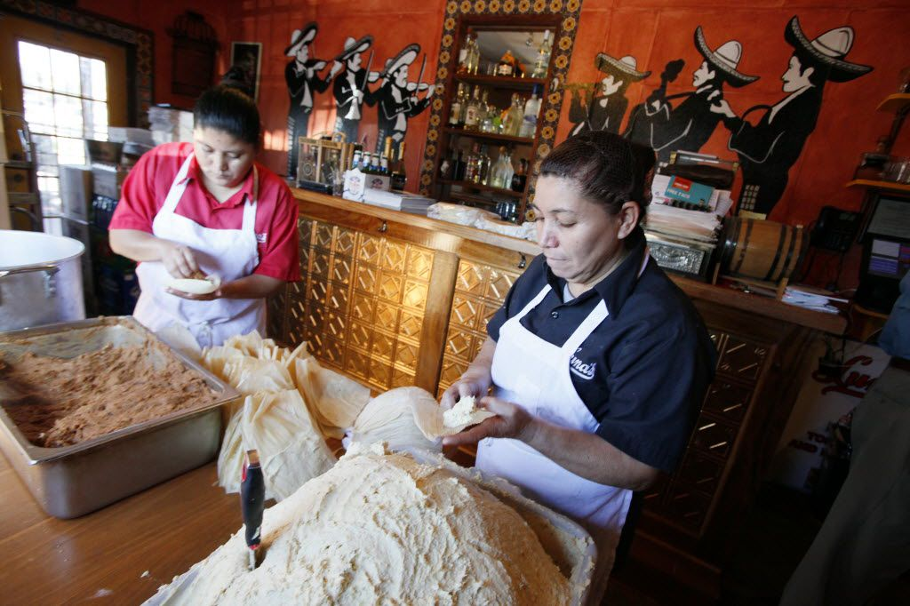 Maria Milan and Armandina Flores prepare tamales to sell for the holidays at Luna's Tortilla Factory.