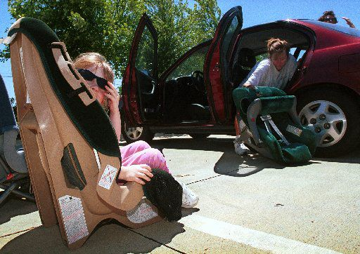 """""""It is not necessary to micromanage the parenting process to such a great extent,"""" Gov. Greg Abbott wrote Saturday as he vetoed a bill that would have required Texas parents to place children under 2 in rear-facing car seats."""