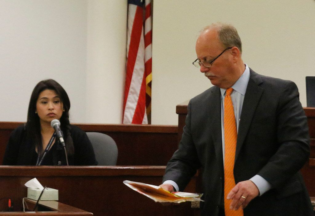 Defense attorney J. Warren St. John (right) promised to gain an acquittal for his client Ken Martin who murdered his wife. St. John didn't keep his promise. Here, he questions Peggy Le, a forensic biologist, about evidence.