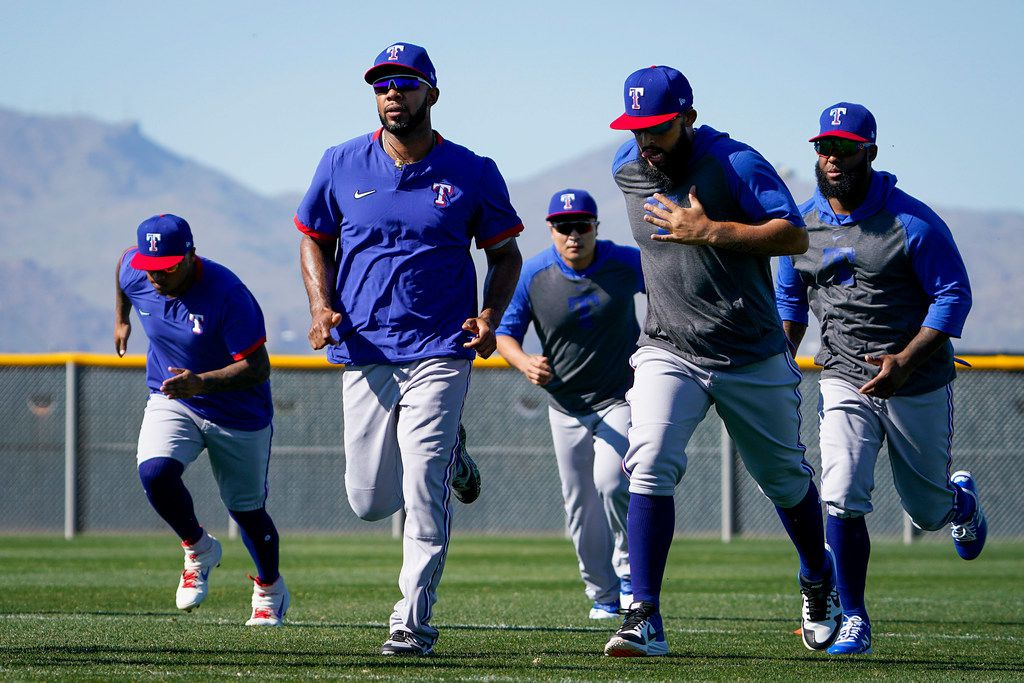 Texas Rangers players (from left) Willie Calhoun, Elvis Andrus, Shin-Soo Choo, Rougned Odor and Joey Gallo run on a conditioning field during a spring training workout at the team's training facility on Thursday, Feb. 20, 2020, in Surprise, Ariz.