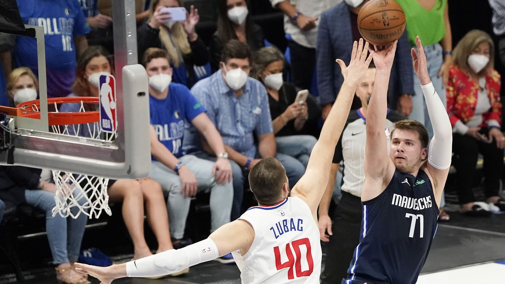 Dallas Mavericks guard Luka Doncic (77) shoots over LA Clippers center Ivica Zubac (40) during the first quarter of an NBA playoff basketball game at American Airlines Center on Friday, May 28, 2021, in Dallas.