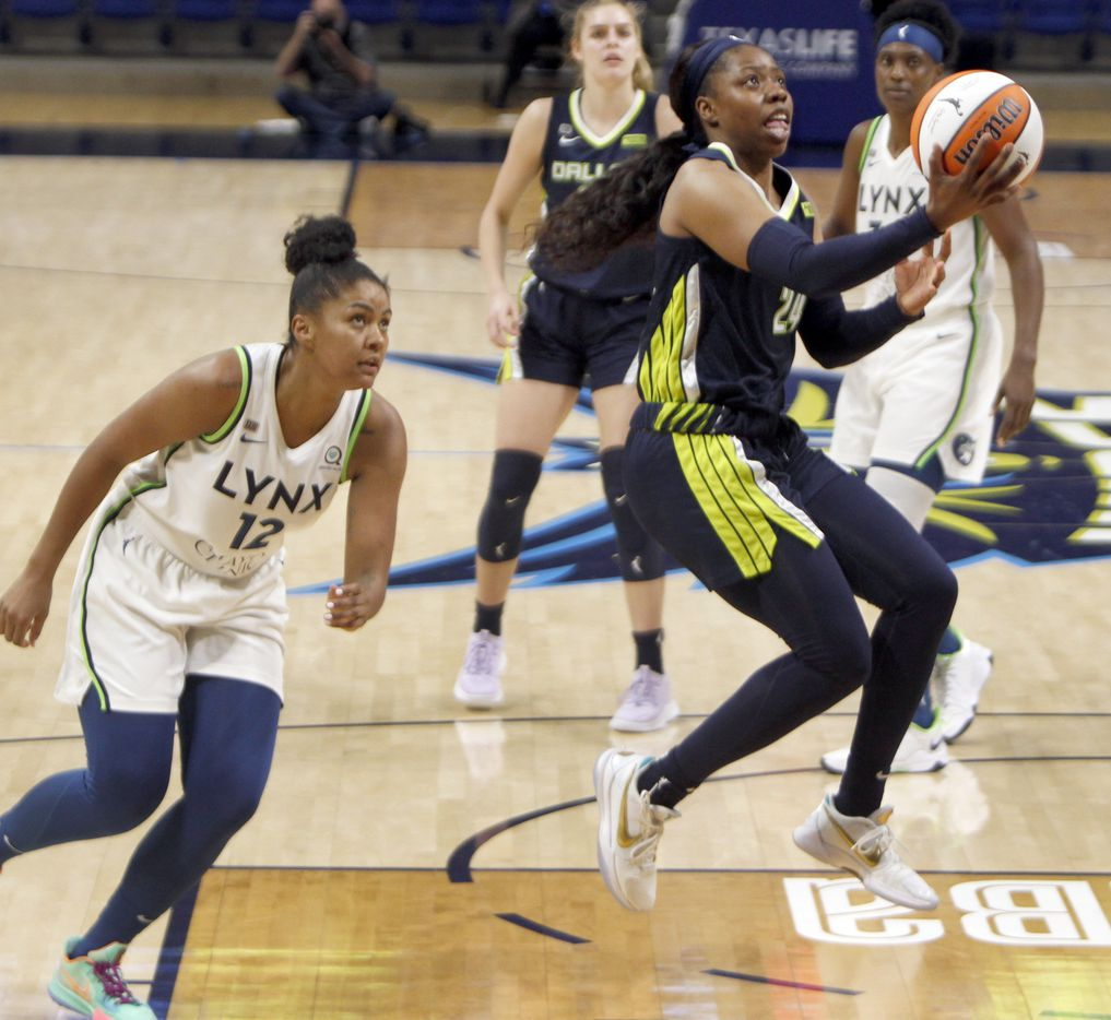 Dallas Wings guard Arike Ogunbowale (24) skies to the basket for a layup after avoiding the defense of Minnesota Lynx forward Damiris Dantas (12) during 4th quarter action. Minnesota defeated Dallas 85-73. The two teams played their WNBA game at College Park Center on the campus of the University of Arlington on June 17, 2021(Steve Hamm/ Special Contributor)