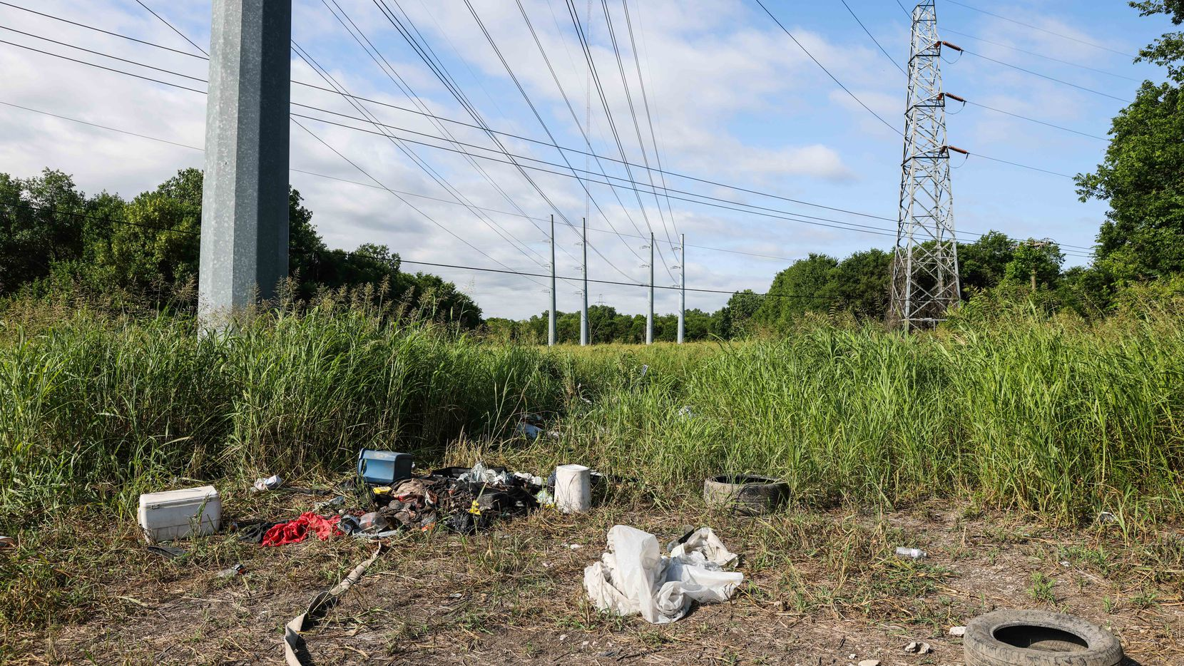 Trash, cast-off belongings and other illegal dumping are visible through much of the undeveloped land that will  become part of the Trinity Forest Spine Trail.