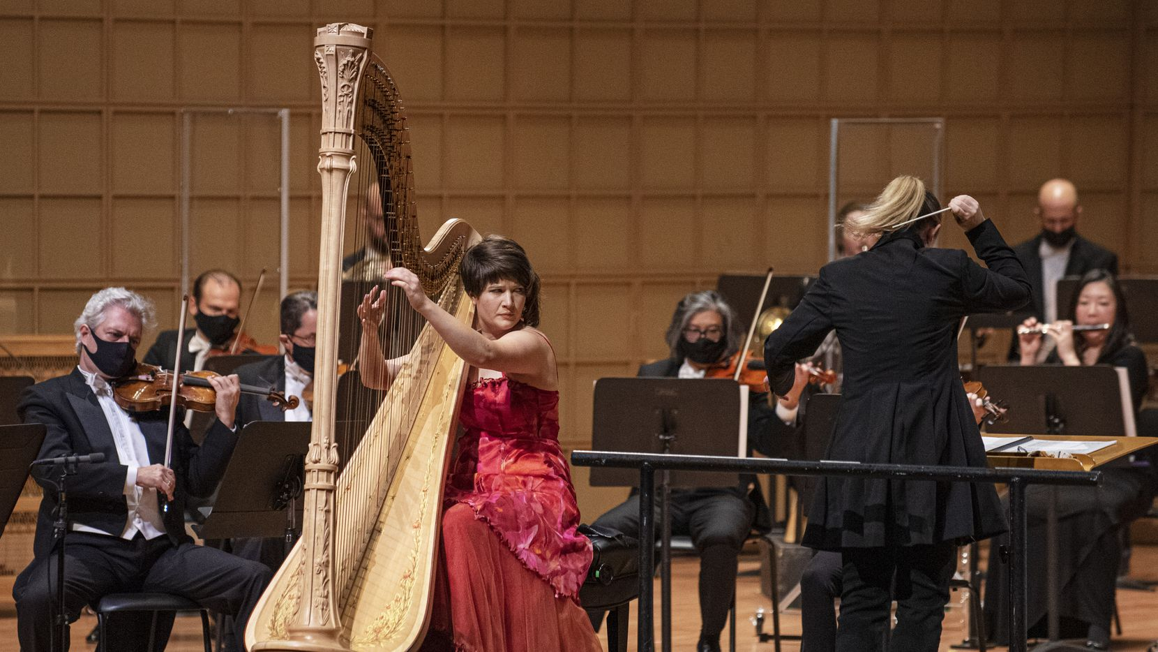 Harpist Emily Levin (left) performs the Harp Concerto by Alberto Ginastera with principal guest conductor Gemma New and the Dallas Symphony Orchestra at the Morton H. Meyerson Symphony Center in downtown Dallas on Sept. 24, 2020.