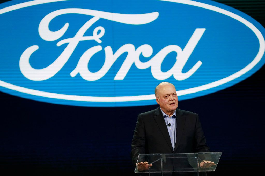 FILE- In this Jan. 14, 2018, file photo Ford President and CEO Jim Hackett prepares to address the media at the North American International Auto Show in Detroit. Hackett said Wednesday, Sept. 16, during a television interview that the Trump administration's tariffs on imported steel and aluminum will cost the company $1 billion. (AP Photo/Carlos Osorio, File)