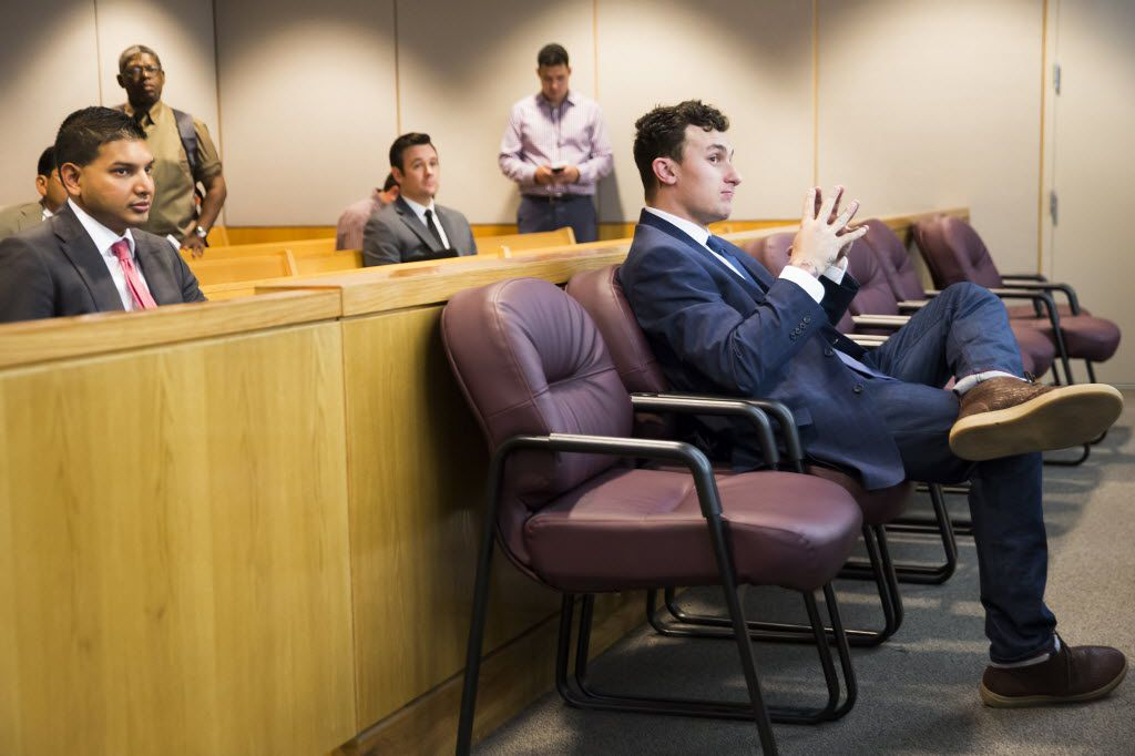 Former Texas A&M and Cleveland Browns quarterback Johnny Manziel sits at the back of the courtroom while his defense attorneys confer with the prosecution after he appeared before Judge Roberto Cañas at the Frank Crowley Courts Building on Thursday, May 5, 2016, in Dallas. Manziel reported to court Thursday for the first time since a Dallas County grand jury indicted him last month on a misdemeanor domestic violence charge. Former girlfriend Colleen Crowley has accused him of kidnapping, hitting and threatening to kill her in January. (Smiley N. Pool/The Dallas Morning News)
