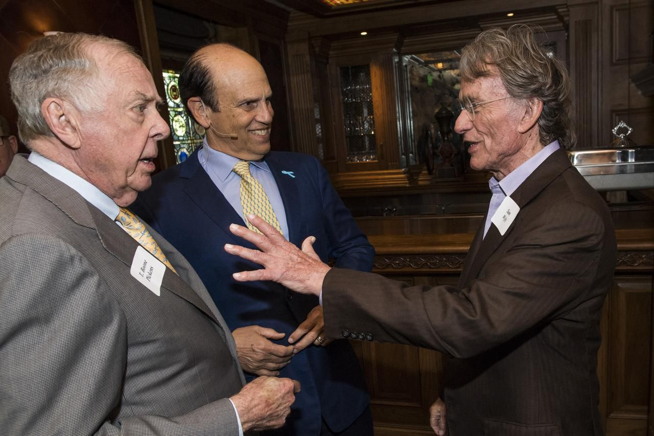 T. Boone Pickens  (left) and Mike Milken chatted with Sam Wyly at a June 3 luncheon. Milken says the famous Dallas entrepreneurs are two of his biggest junk bond success stories.