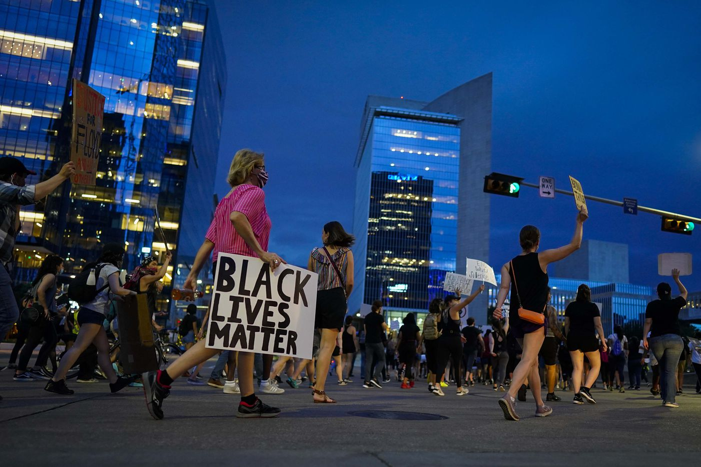 A group of marchers heads toward the Federal Reserve Bank of Dallas after rally for Juneteenth at Klyde Warren Park on Friday, June 19, 2020, in Dallas.