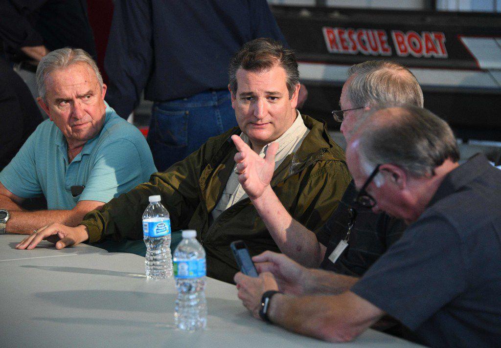 Texas Sen. Ted Cruz (center) listens during a briefing on Hurricane Harvey in Corpus Christi on Aug. 29.