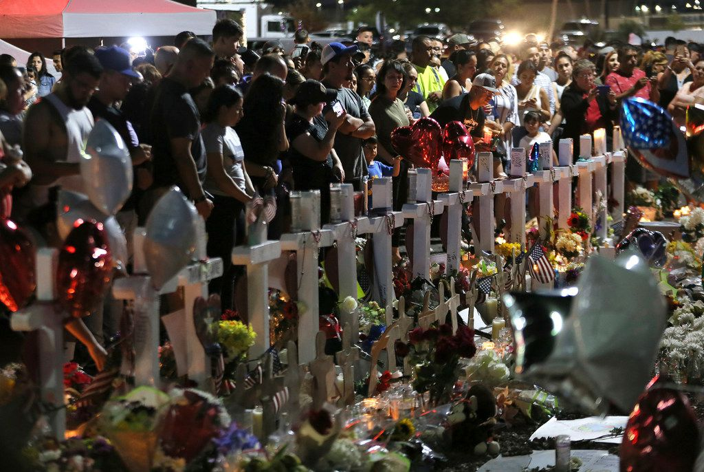 Hundreds of people hold vigil Aug. 5, 2019, outside the Walmart in El Paso, where a mass shooting took place on Saturday.