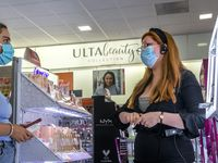 Co-manager Samantha Corral (right) helps Alex Coulson pick out makeup products at Ulta Beauty.