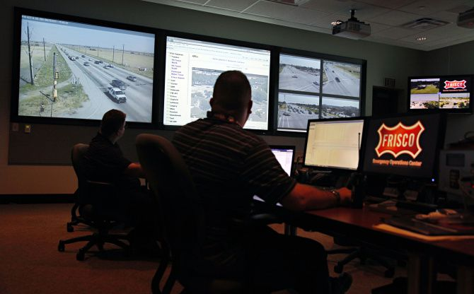 Officials monitor traffic camera activity while manning the Frisco Fire Department's Emergency Operations Center room in Frisco.