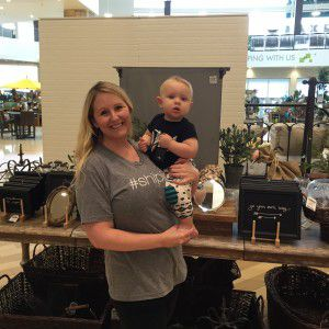Kim Goodson is a big fan of HGTV's Fixer Upper couple. She was just at the Magnolia Market at the Silos in Waco last week where she purchased that #Shiplap t-shirt she's wearing. Gray is her favorite color. She's holding her son Grayson.