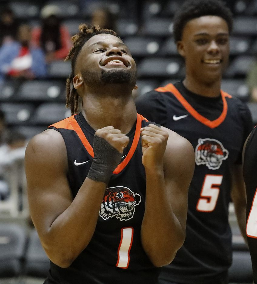 Lancaster High School guard Mike Miles (1) celebrates the moment as time expires with  a win as Kimball High School played Lancaster High School for the Class 5A Region II championship at the Curtis Colwell Center in Garland on Saturday, March 7, 2020.