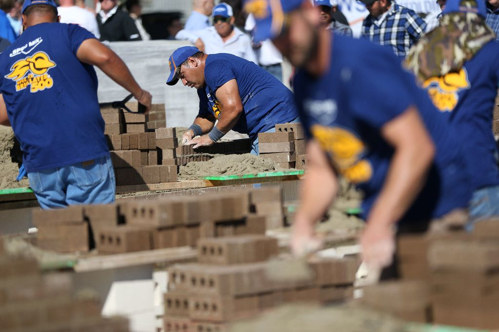 An Artisan Masonry Incorporated mason lays a brick while competing in the North Texas Spec Mix Bricklayer 500 Regional competition in Dallas on Thursday, October 11, 2018. The winning team will compete in the World Championship competition in Las Vegas, Nevada on January 23. (Daniel Carde/The Dallas Morning News)