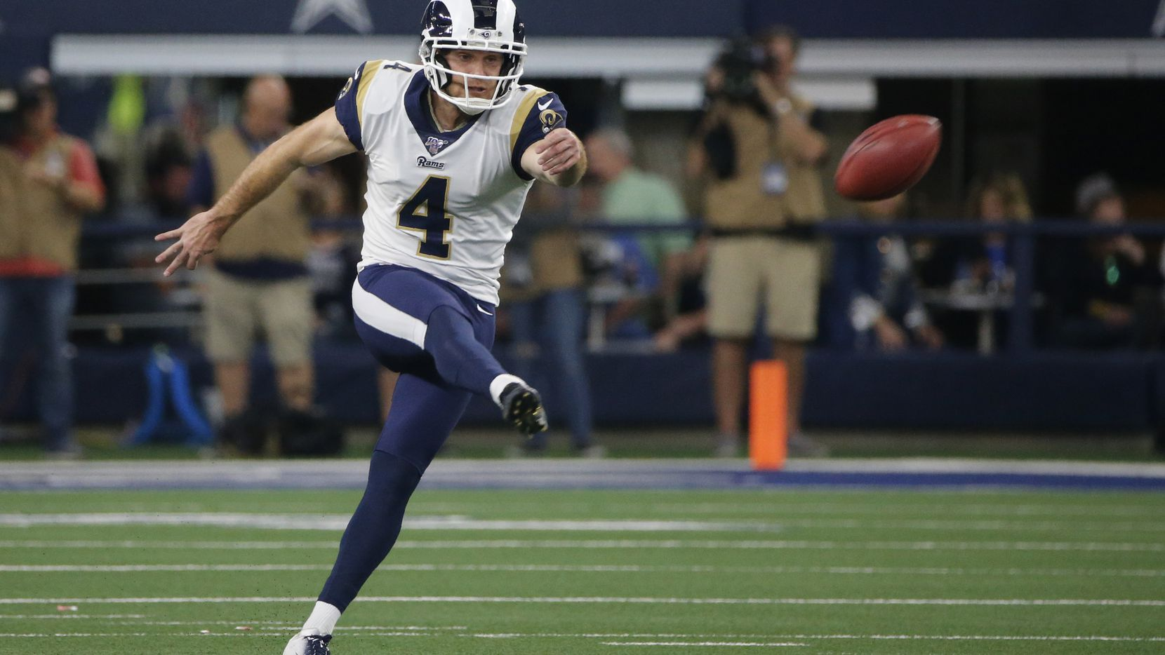 FILE - In this Dec. 15, 2019 file photo, Los Angeles Rams kicker Greg Zuerlein (4) kicks during a game against the Cowboys in Arlington. (AP Photo)