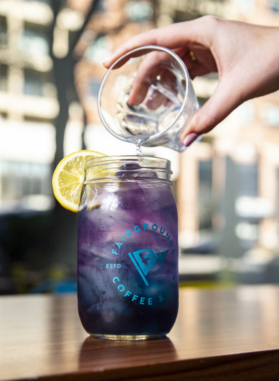 Some of Fairgrounds' elixirs change colors. Here's the Butterfly Pea Flower Arnold Palmer made with jasmine simple syrup, which is blue. When lemonade is added, it turns purple.